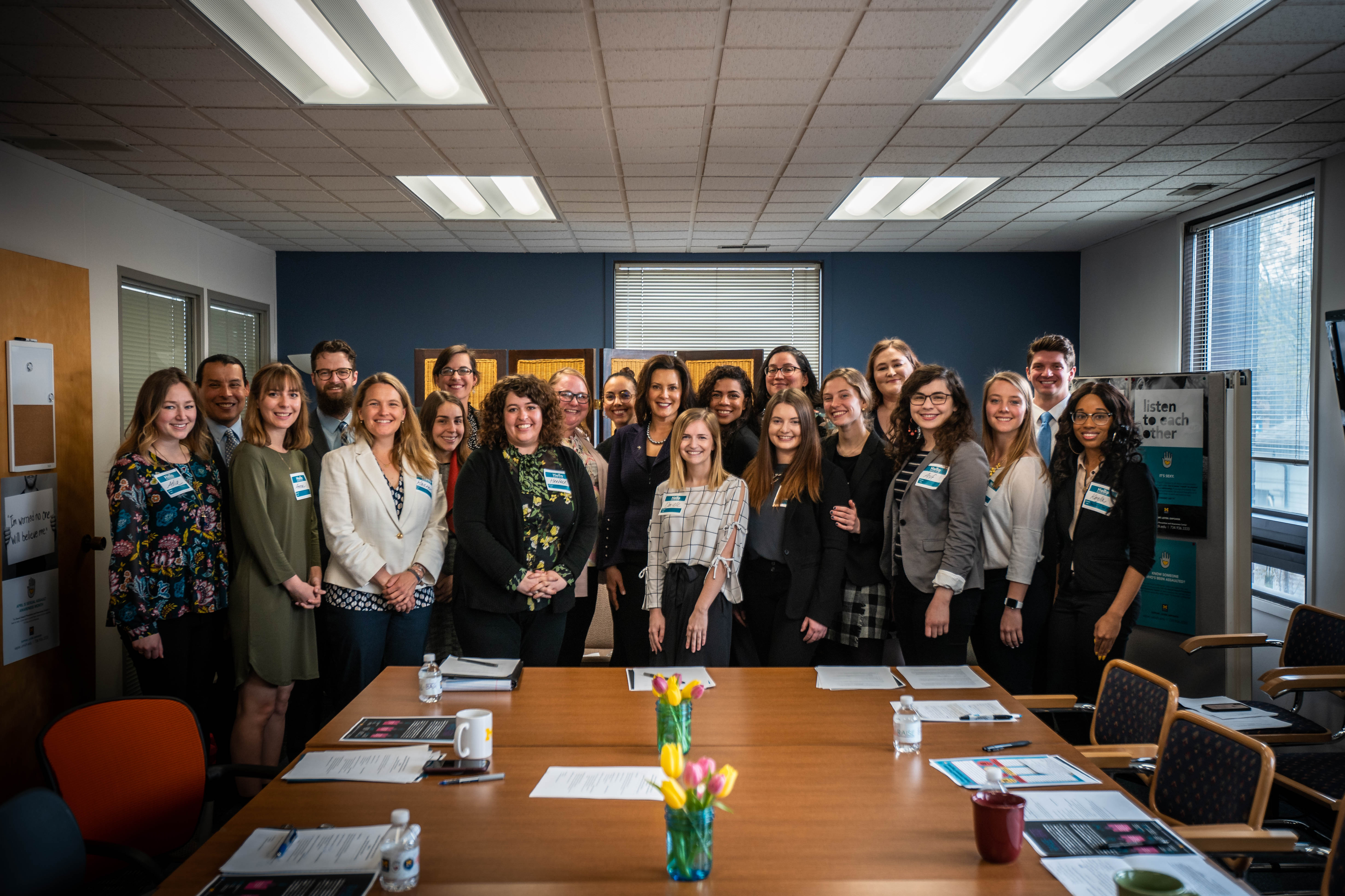 SAPAC Staff members and student leaders standing with Governor Whitmer for a group photo.