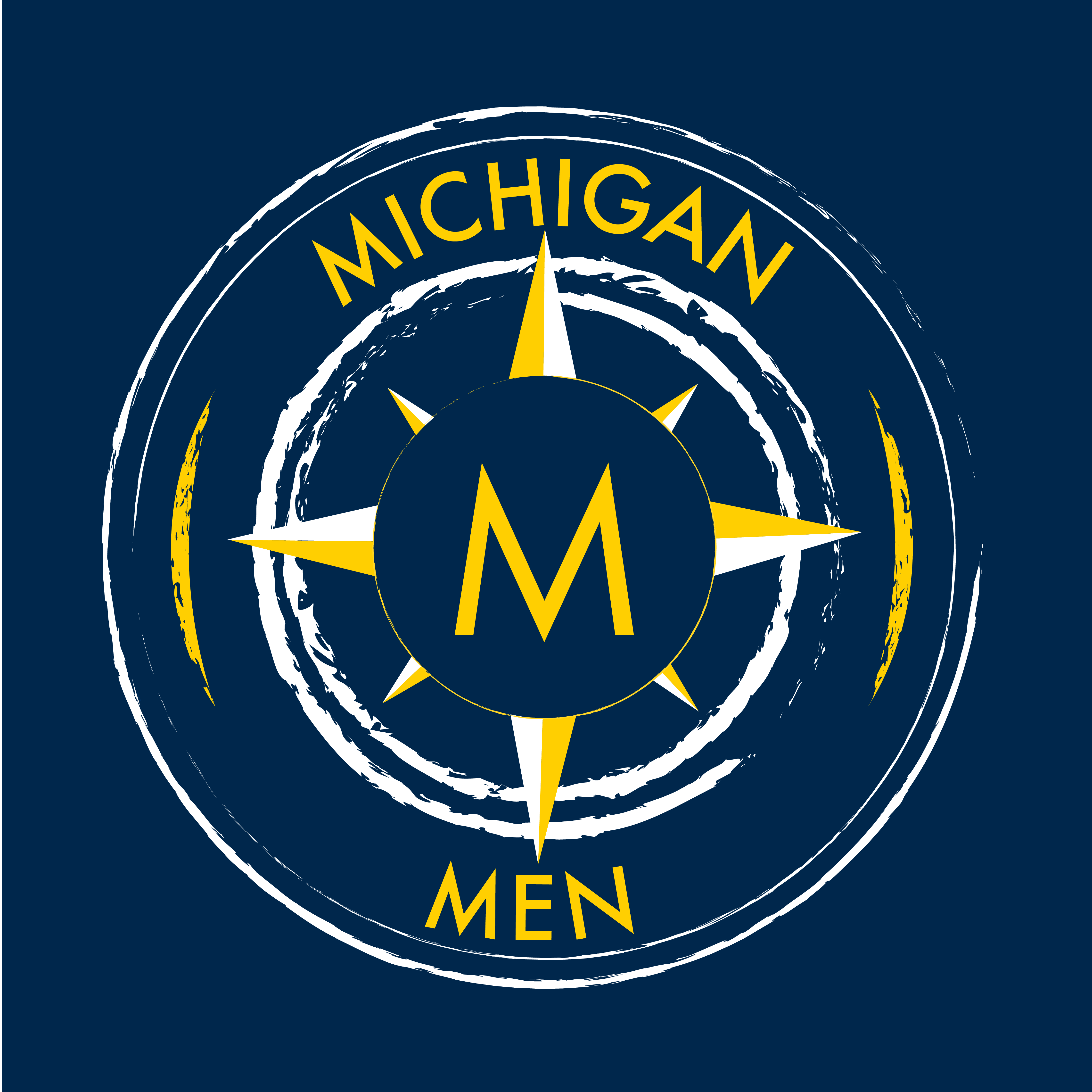 A maize and blue compass with an M in the center.