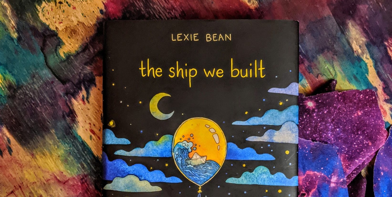 Cover of The Ship We Built, which features night sky and hot air balloon.
