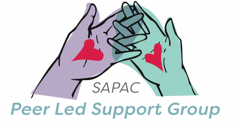 "A purple and a green hand, both with hearts on their palms, interlocking fingers over text that reads ""SAPAC Peer Led Support Group"""