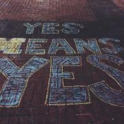 "Chalk art which says: ""Yes Means Yes"""